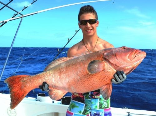 Julien and his nice red coral trout on jigging - Rod Fishing Club - Rodrigues Island - Mauritius - Indian Ocean