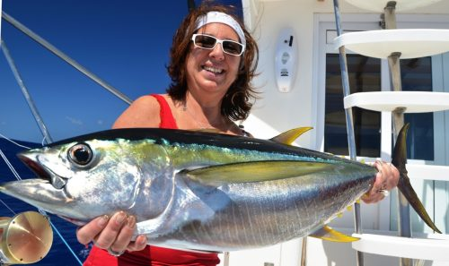 Mary and his yellowfin tuna on trolling - Rod Fishing Club - Rodrigues Island - Mauritius - Indian Ocean