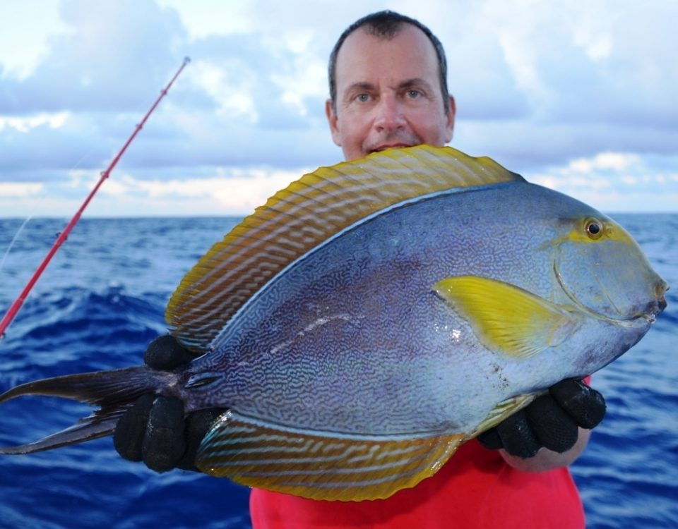 Bruno and his surgeon fish on bottom fishing - Rod Fishing Club - Rodrigues Island - Mauritius - Indian Ocean