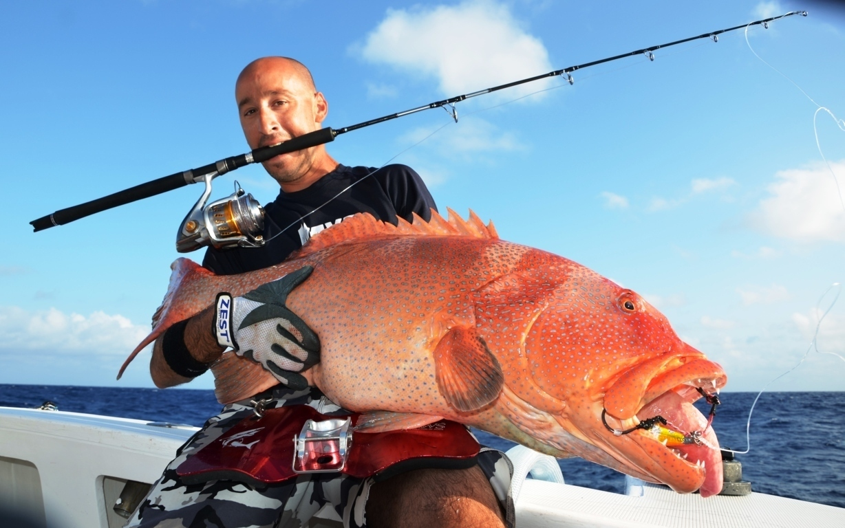 Eran with a Red corail trout caught on jigging on 2014  - Rod Fishing Club - Rodrigues Island - Mauritius - Indian Ocean